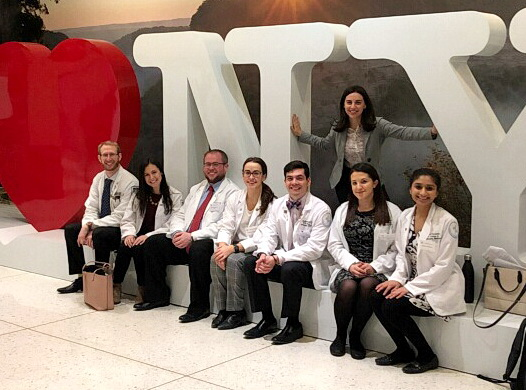 Medical students posing at I Love NY sign